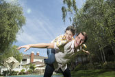 Young Girl Playing with Her Big Brother — Stock Photo