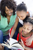 Mother and Daughters Reading a Book — Stock Photo