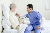 Male Nurse Assisting an Elderly Patient — Stock Photo