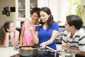 Same Sex Couple Cooking with their Kids — Stock Photo