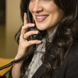Smiling business woman on the phone — Stock Photo