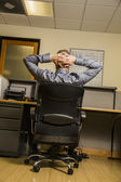 Man relaxing for a moment at work — Stock Photo