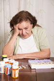 Elderly woman with medication — Stock Photo