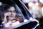 Businessman looking out the car window — Stock Photo