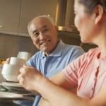 Senior couple sharing tea — Stock Photo #36081063