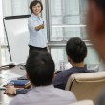 Woman Giving Business Presentation — Stock Photo #36081087