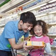 Father and Daughter Looking at Juice Box — Stock Photo #36080573