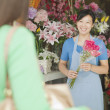 Customer Buying Bunch Of Flowers In Flower Shop — Stock Photo
