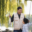 Grandfather and grandson fishing — Stock Photo #36081317