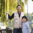 Grandfather and grandson fishing — Stock Photo #36081447