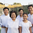 Family playing tennis, portrait — Stock Photo