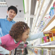 Little Girl Reaching for Food in Supermarket — Stock Photo