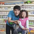 Father and Daughter Shopping in Supermarket — Stock Photo