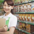 Female Sales Clerk Working in a Supermarket — Stock Photo