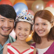 Portrait of Family on Daughter's Birthday — Stock Photo