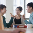 Coworkers eating and working in the cafeteria — Stock Photo #36082233