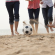 Young Friends Playing Soccer on the Beach — Stock Photo #36082441