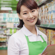 Portrait of Female Sales Clerk in a Supermarket — Stock Photo