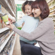 Mother and Daughter in Supermarket — Stock Photo #36082787
