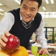 Teacher reaching for healthy food in school cafeteria — Stock Photo #36082823