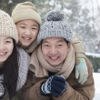Family laying in snow — Stock Photo #36083049