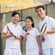 Family playing tennis — Stock Photo