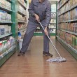Caretaker Cleaning Floor in Supermarket — Stock Photo