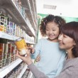 Mother and Daughter in Supermarket — Stock Photo #36083789