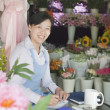 Florist Working In Flower Shop — Stock Photo #36085013