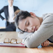 Young businesswoman sleeping during meeting — Stock Photo #36085373