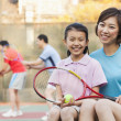 Mother and daughter playing tennis — Stock Photo #36085417