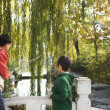 Grandfather and grandson fishing — Stock Photo #36085469