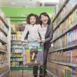 Mother and Daughter Having Fun in Supermarket — Stock Photo