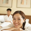 Young Couple Lying on Bed — Stock Photo #36085541