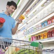 Young Man Making Decisions About Food — Stock Photo