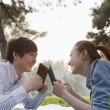 Stock Photo: Teenage couple reading books in park