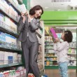 Mother and Daughter Having Fun in Supermarket — Stock Photo #36086493