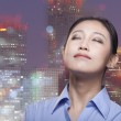 Smiling businesswoman, cityscape of Beijing — Stock Photo #36086817