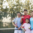 Family playing tennis, portrait — Stock Photo #36087001