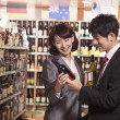 Couple Choosing Wine in a Liquor Store	 — Stock Photo