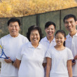 Family playing tennis, portrait — Stock Photo #36087183