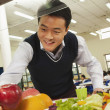 Teacher reaching for healthy food in school cafeteria — Stock Photo #36087205