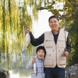 Grandfather and grandson fishing — Stock Photo #36087317