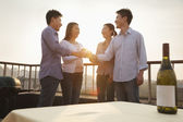 Group of Friends Toasting Each Other on Rooftop at Sunset — Stock Photo