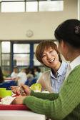 Teachers talking at lunch in school cafeteria — ストック写真