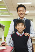 Teacher and school boy in school cafeteria — Stock Photo