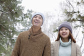 Couple smiling in park in winter — Stock Photo