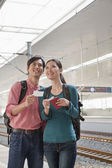 Couple Checking The Train Schedule — Stock Photo