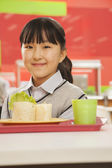 School girl in school cafeteria — Stock Photo