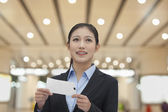 Businesswoman at the airport — Stock Photo